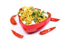Spicy hakka noodles. Spicy hakka nodles with red chillies isolated on white background Stock Photos