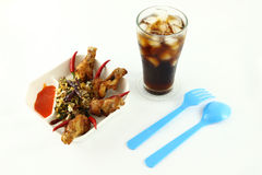 Spicy herb fried chicken meal. Spicy herb fried chicken wings and black beverage royalty free stock images