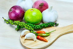 Spicy herbs on wooden ladle and chopping board Royalty Free Stock Photos