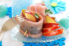 Spicy herring rolls with apple and gherkin for easter Stock Images
