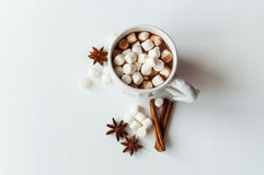 Spicy hot cocoa with marshmallows. In a white mug on a white background Stock Photo