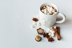 Spicy hot cocoa with marshmallows. In a white mug on a white background Stock Image
