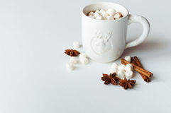 Spicy hot cocoa with marshmallows. In a white mug on a white background Royalty Free Stock Photo