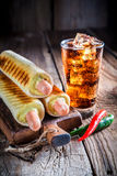 Spicy hot dog with cold drink Stock Photo