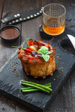 Spicy hot grilled crown ribs served on an old vintage wooden cutting board with vegs inside Royalty Free Stock Image