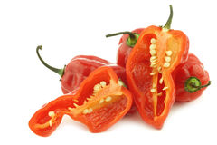 Spicy hot red adjuma peppers and a cut one Stock Photo