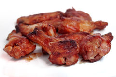 Spicy Hot Wings. Spicy grilled hot wings isolated on white Stock Photos