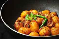 Spicy Indian potato curry with green chillies Royalty Free Stock Image