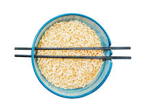 Spicy instant noodles in bowl with chopsticks Stock Photos