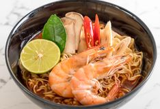 Spicy instant noodles soup with shrimp. (tom yum Stock Image
