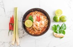 Spicy instant noodles soup with shrimp. (tom yum Stock Photo