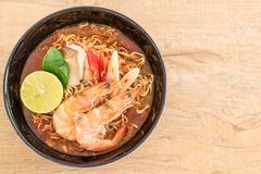 Spicy instant noodles soup with shrimp. (tom yum Royalty Free Stock Image