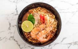 Spicy instant noodles soup with shrimp. (tom yum Stock Images