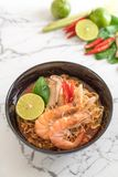 Spicy instant noodles soup with shrimp. (tom yum Royalty Free Stock Photography