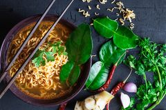 Spicy instant noodles soup And vegetables on a black background royalty free stock photo