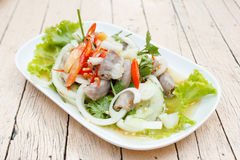 Spicy intestines pork salad with vegetable Stock Photos