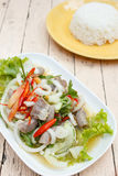 Spicy intestines pork salad with vegetable Stock Photo
