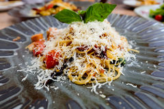Spicy Italian favourite pasta dish spaghetti bolognese with parmesan cheese. Spicy Italian favourite pasta dish spaghetti bolognese Stock Images