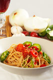 Spicy italian pasta tomato and chili peppers sauce Stock Image