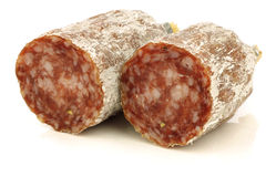 Spicy Italian salami sausage halves Royalty Free Stock Photo