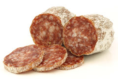 Spicy Italian salami sausage and some slices Royalty Free Stock Photography