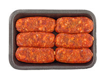 Spicy Italian Sausages On Black Tray. Six spicy Italian sausages on a black meat tray royalty free stock photo