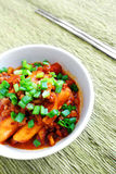 Spicy Korean rice cakes with sauce stock images