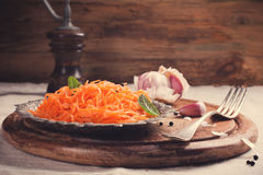 Spicy Korean style carrot salad on metal plate Stock Photos