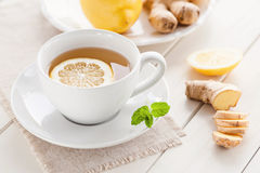Spicy lemon ginger tea. Cup of ginger tea with fresh lemon Royalty Free Stock Images