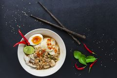Spicy lemongrass soup noodle with Soft-boiled eggs top view royalty free stock photos