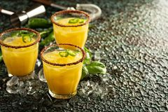 Spicy mango margaritas with hot pepper. Refreshing spicy mango margaritas with hot pepper Stock Photo