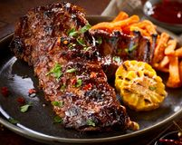 Spicy marinated barbecued portion of spare ribs Stock Image