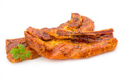 Spicy marinated spare ribs barbecued on the white background. Stock Image