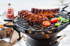 Spicy marinated spare ribs grilling outdoors stock photo