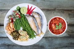 Spicy meat and tomato dip,Nam Prik Ong,with side dish. Isolated of spicy meat and tomato dip,Nam Prik Ong in Thai,Northern style chili and tomato dip ,with side stock photos