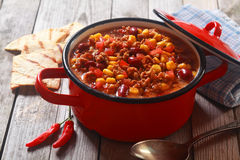 Spicy Meaty Recipe on Red Pot Placed on Table Royalty Free Stock Photography