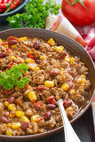 Spicy Mexican dish chili con carne in pottery plate Royalty Free Stock Images