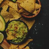 Spicy Mexican Food, Corn Nachos and Guacamole Sauce, Food Background, Top View stock images