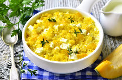 Spicy millet casserole with pumpkin and feta. Stock Image