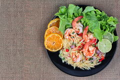 Spicy minced mango salad with shrimp. Have text space on left. Stock Photo