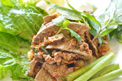 Spicy minced pork and liver salad eat couple with fresh vegetable on plate Royalty Free Stock Images