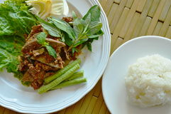 Spicy minced pork and liver salad eat couple with sticky rice Stock Image