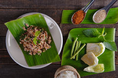 Spicy minced pork salad on fresh banana leaf. And ingredient Royalty Free Stock Image