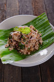 Spicy minced pork salad on fresh banana leaf. And ingredient Stock Image