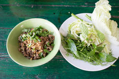 Spicy minced pork salad, minced pork mash with spicy, Thai food. Thai spicy salad with minced and pork on white background , thai food Stock Image