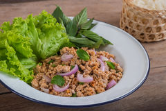 Spicy minced pork salad and sticky rice, Thai food Stock Photography