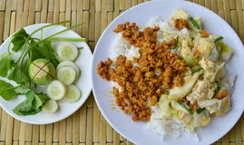 Spicy minced pork yellow curry paste and stir fried cabbage with egg on rice Stock Photos