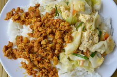 Spicy minced pork yellow curry paste and stir fried cabbage with egg on rice Royalty Free Stock Photo