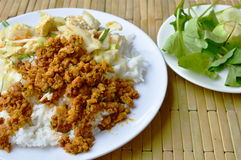 Spicy minced pork yellow curry paste and stir fried cabbage with egg on rice Royalty Free Stock Image
