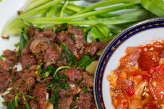 Spicy minced raw meat salad meat with spicy sauce. Spicy minced raw meat salad meat with spicy sauce/ thai food stock photography